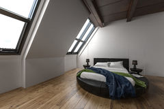 Modern attic apartment with slanted windows Royalty Free Stock Photo