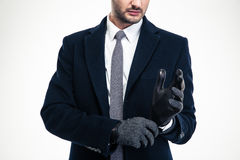 Modern attractive businessman in classic suit wearing fashionable gloves Stock Photography