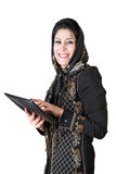 Modern attractive islamic woman with tablet pc. Picture of a modern attractive islamic woman with tablet pc Stock Photos