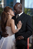 Modern attractive multi racial couple. Modern attractive multi racial wedding couple royalty free stock images