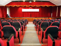 Modern Auditorium with Red Curtains Stock Images