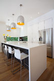 Modern Australian kitchen renovation with waterfall island bench Royalty Free Stock Images