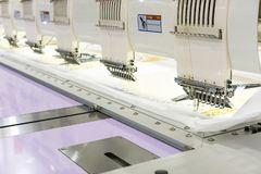 Modern and automatic high technology sewing machine for textile or clothing apparel making manufacturing process in industrial.  royalty free stock photos