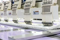 Modern and automatic high technology sewing machine for textile or clothing apparel making manufacturing process in industrial.  stock images