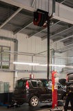 Modern automobile service station with fumes exhaust vetillation unit and elevators Stock Photo