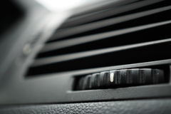 Modern automotive car air conditioning (car ventilation vent) with gradient rounded control wheel in black color. Modern automotive car air conditioning (car stock images
