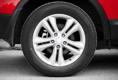 Modern automotive wheel Stock Images