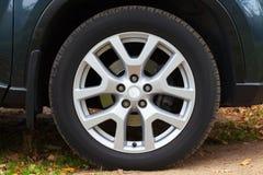 Modern automotive wheel on alloy disc Royalty Free Stock Photo