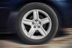 Modern automotive wheel on light alloy disc Royalty Free Stock Image