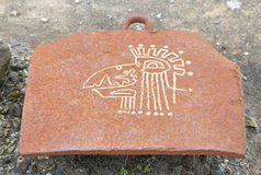 Modern Aztec Graffiti. A modern Aztec figurine inscribed on a metal platform in an abandoned shipyard Royalty Free Stock Photography