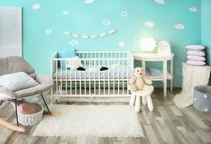 Modern baby room interior with crib. And rocking chair Stock Images