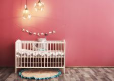 Modern baby room interior with crib. Near color wall Royalty Free Stock Photo