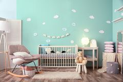 Modern baby room interior with crib. And rocking chair stock photo