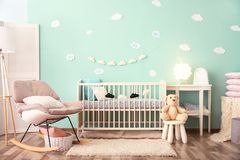 Modern baby room interior with crib. And rocking chair stock photography