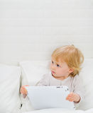 Modern baby with tablet PC Stock Photo