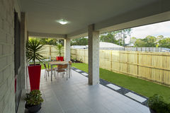 Modern backyard. With entertaining area in stylish Australian home Royalty Free Stock Photography