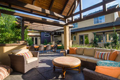 Modern Backyard Living Room. An upscale backyard terrace featuring perennials and with a custom designed shelter and fireplace Stock Photography