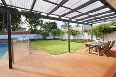 Modern backyard with pool Royalty Free Stock Photos