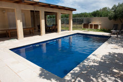 Modern backyard with swimming pool Stock Images