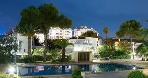 Modern backyard water pool. Royalty Free Stock Images