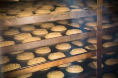 Modern bakery in confectionery factory. Cookies in the oven. Modern bakery in confectionery factory. Industrial ovens for baking biscuits, cakes and cookies royalty free stock photography