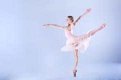 Modern Ballerina dancing in the studio Stock Images