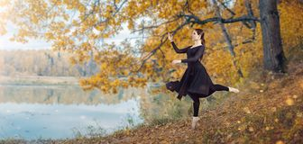 Modern ballet dancer in the autumn park. By the lake. Freedom, harmony and unity with nature stock photos