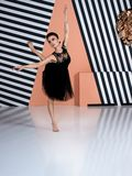 Modern ballet dancer, ballerina performing art dance element with copy space background. Modern ballet dancer in black dress performing art jump element with royalty free stock images