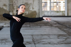 Modern ballet dancer exercising and dancing in abandoned building Royalty Free Stock Images