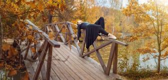 Modern ballet dancer in the autumn park Royalty Free Stock Photo
