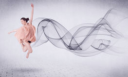 Modern ballet dancer performing with abstract swirl Stock Images