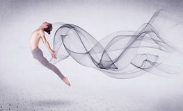 Modern ballet dancer performing with abstract swirl Stock Photography