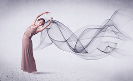 Modern ballet dancer performing with abstract swirl Royalty Free Stock Images