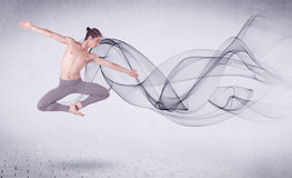 Modern ballet dancer performing with abstract swirl Stock Photos