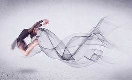 Modern ballet dancer performing with abstract swirl. Concept on background royalty free stock images