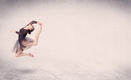 Modern ballet dancer performing art jump with empty background Stock Photos