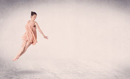 Modern ballet dancer performing art jump with empty background Royalty Free Stock Images