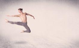 Modern ballet dancer performing art jump with empty background. Modern ballet dancer performing art jump with empty copy space background stock photo