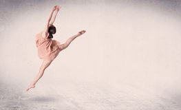 Modern ballet dancer performing art jump with empty background. Modern ballet dancer performing art jump with empty copy space background Royalty Free Stock Photos