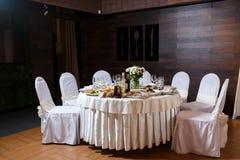 Modern banquet hall. Decorated tables, elegant setting, beautifu. L interior Royalty Free Stock Image