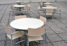 Modern bar. Tables and chairs made of plastic and aluminum floor rocks stock photo