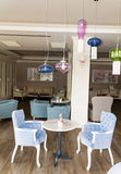 Modern bar interior with blue chairs Stock Photo