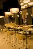 Modern bar restaurant interior. A modern bar restaurant with beautiful lighting Royalty Free Stock Photography