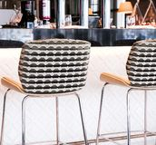 Modern bar stool in a luxury restaurant. Interior design, furniture decor and nightlife concept - Modern bar stool in a luxury restaurant royalty free stock photos