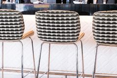 Modern bar stool in a luxury restaurant. Interior design, furniture decor and nightlife concept - Modern bar stool in a luxury restaurant royalty free stock images