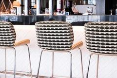 Modern bar stool in a luxury restaurant. Interior design, furniture decor and nightlife concept - Modern bar stool in a luxury restaurant royalty free stock photo