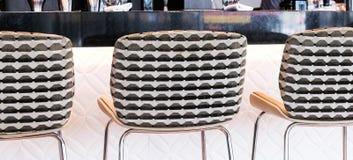 Modern bar stool in a luxury restaurant. Interior design, furniture decor and nightlife concept - Modern bar stool in a luxury restaurant stock photography