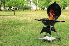 Barbecue grill with fire flames outdoors. Modern barbecue grill with fire flames outdoors Royalty Free Stock Images