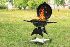 Barbecue grill with fire flames outdoors. Modern barbecue grill with fire flames outdoors Royalty Free Stock Image