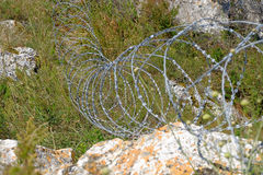 Modern barbed wire fence around a property Royalty Free Stock Photo